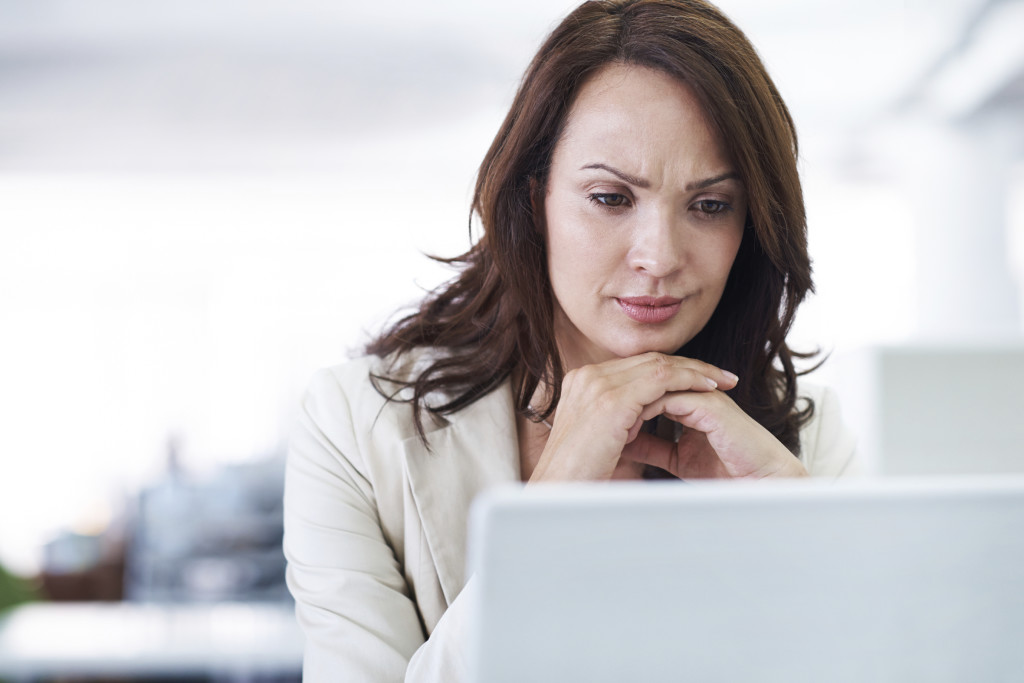 Woman Making Decision in front of Computer Screen