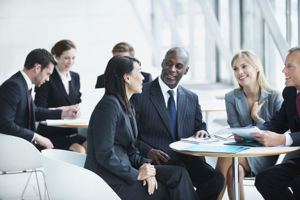 Happy businesspeople in a meeting together