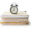 Clock on Stack of File Folders